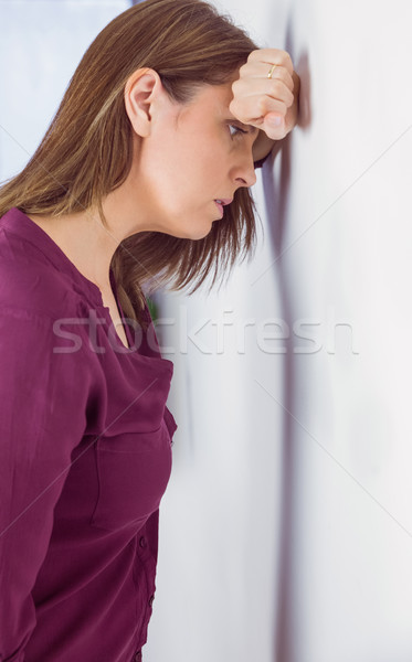 Depressed woman leaning her head against a wall Stock photo © wavebreak_media