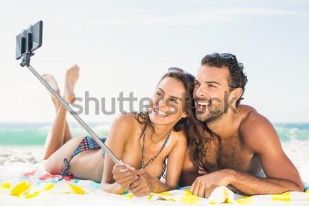Gelukkig paar stick strand vrouw Stockfoto © wavebreak_media