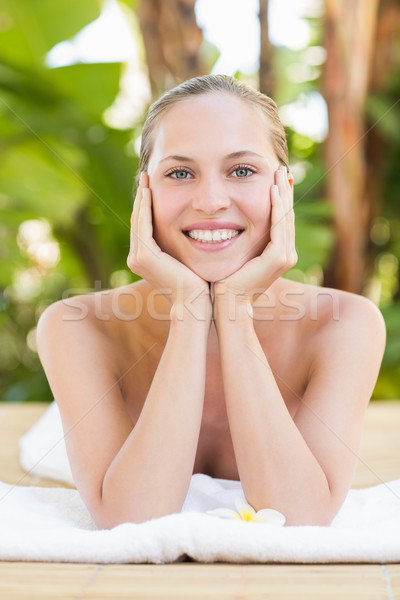 Peaceful blonde lying on towel Stock photo © wavebreak_media