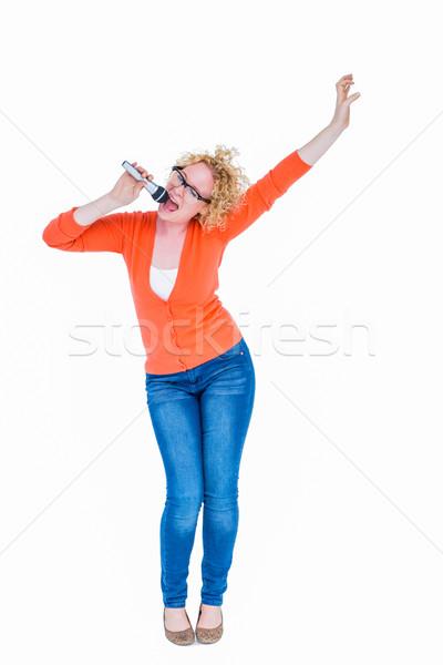 счастливым довольно блондинка пения микрофона белый Сток-фото © wavebreak_media