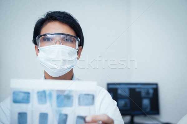 Serious female dentist holding x-ray Stock photo © wavebreak_media