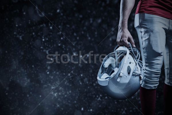 Composite image of cropped image of american football player hol Stock photo © wavebreak_media