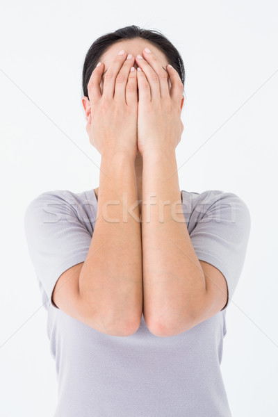 Szomorú nő rejtőzködik arc fehér női Stock fotó © wavebreak_media