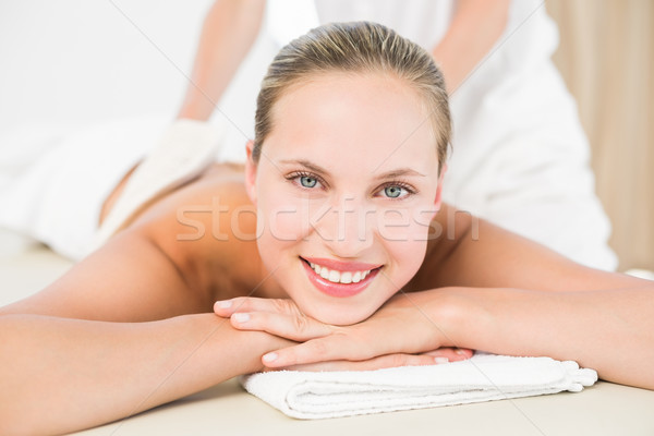 Peaceful blonde enjoying an exfoliating back massage Stock photo © wavebreak_media
