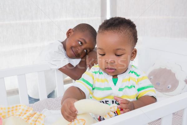 Babyboy and his brother in babyroom  Stock photo © wavebreak_media
