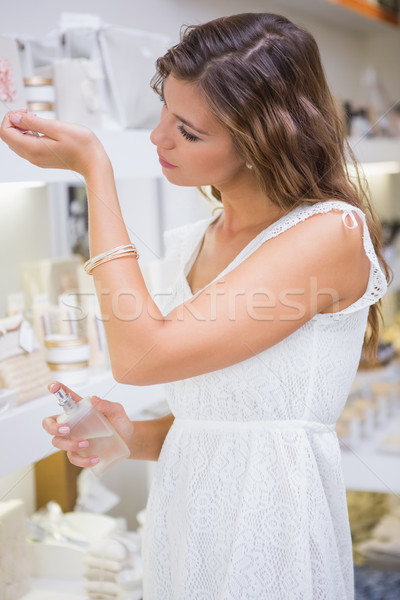 Woman testing perfume Stock photo © wavebreak_media
