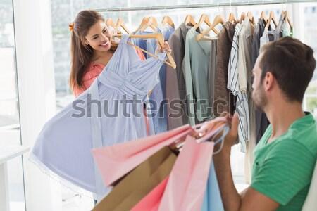 Mujer sonriente ropa hombre boutique femenino Foto stock © wavebreak_media
