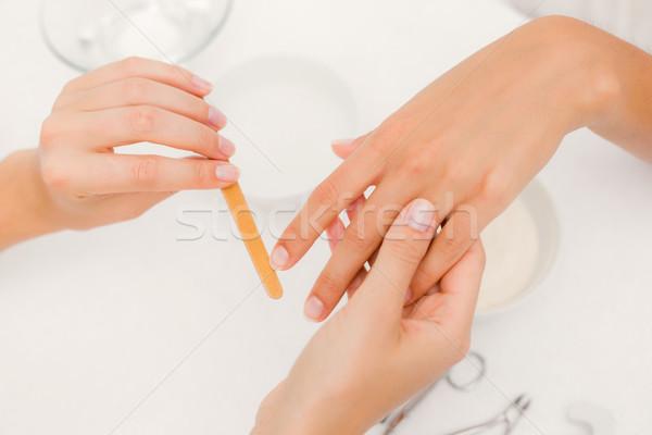 Beautician filing female clients nails at spa beauty salon Stock photo © wavebreak_media
