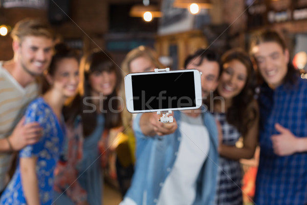 Group of friends taking selfie through mobile phone Stock photo © wavebreak_media