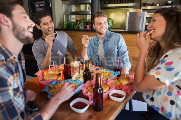 友達 食べ フライドポテト レストラン 座って ストックフォト © wavebreak_media