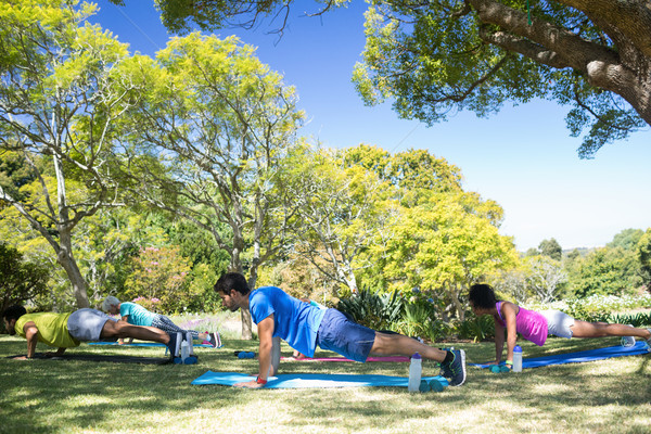 Group of people performing push ups in the park Stock photo © wavebreak_media