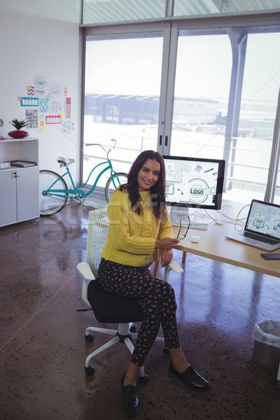 Portré üzletasszony ül irodai asztal teljes alakos üzlet Stock fotó © wavebreak_media
