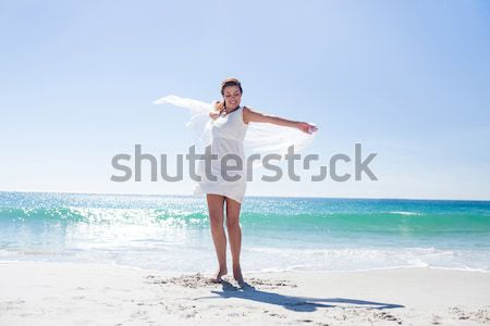 Young man exercising on sand at beach Stock photo © wavebreak_media