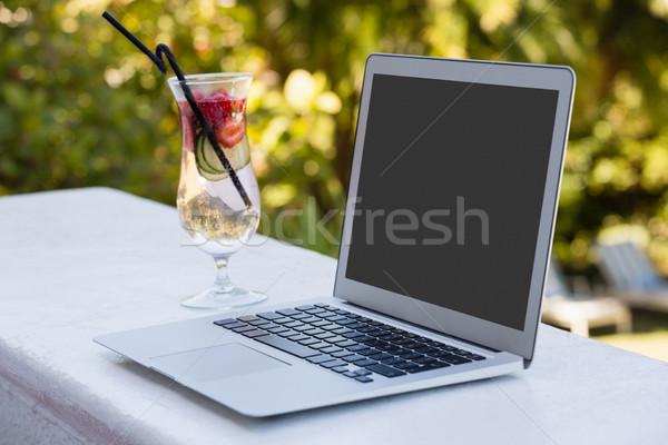 High angle view of laptop and cocktail drink at restaurant Stock photo © wavebreak_media