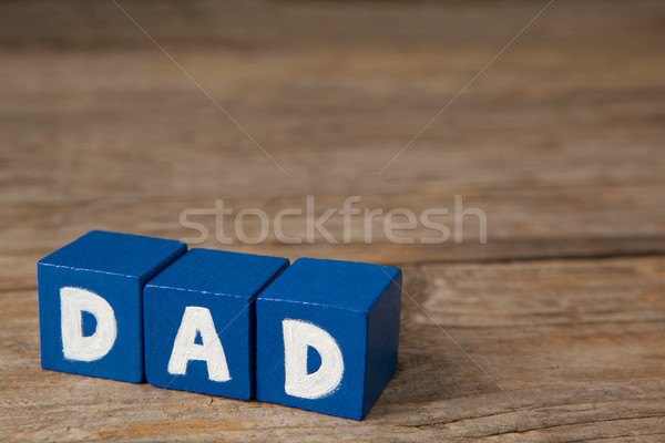 Blocks with text dad on wooden plank Stock photo © wavebreak_media