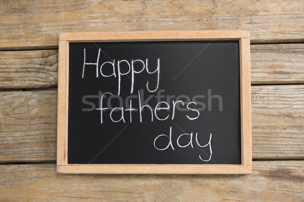 Overhead view of slate with happy fathers day text on table Stock photo © wavebreak_media