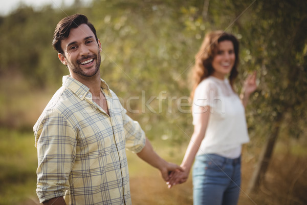 Handsome young man holding woman at olive farm Stock photo © wavebreak_media