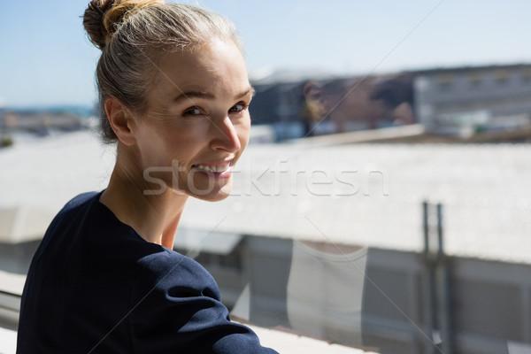 Smiling woman standing by window in office Stock photo © wavebreak_media