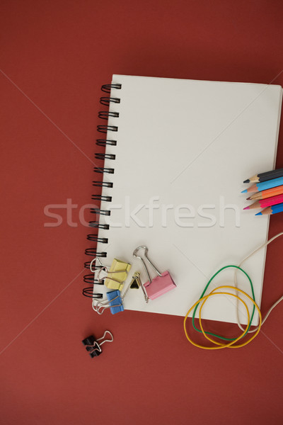 Various school supplies arranged red on background Stock photo © wavebreak_media