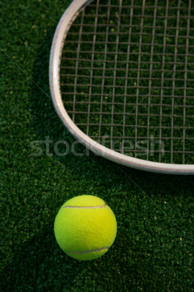 Cropped image of racket by tennis ball Stock photo © wavebreak_media