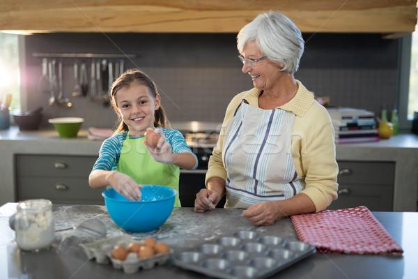 Pronipote uova nonna sorridere cucina Foto d'archivio © wavebreak_media
