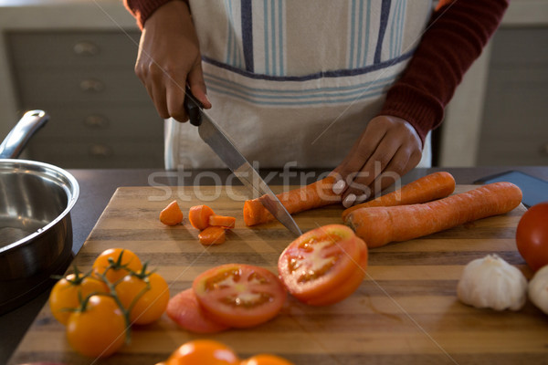 Mid section of woman cutting carrot at counter Stock photo © wavebreak_media