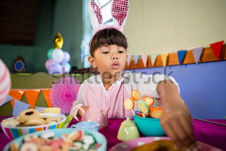Kids playing with tea set during birthday party Stock photo © wavebreak_media
