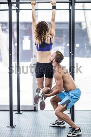спортзал вид сбоку женщину человека Сток-фото © wavebreak_media
