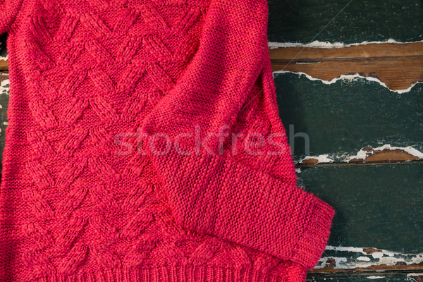 Directly above shot of sweater on wooden table Stock photo © wavebreak_media