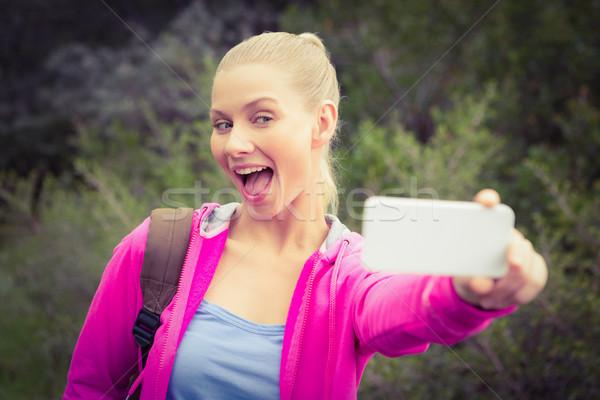 Mosolyog női természetjáró elvesz vicces nő Stock fotó © wavebreak_media