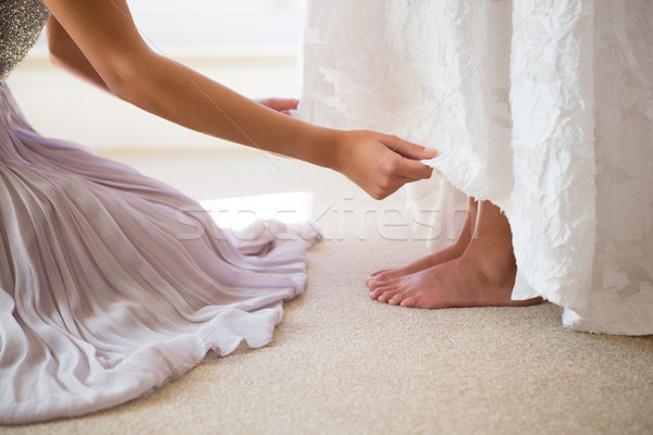 Midsection of bridesmaid assisting bride in getting ready Stock photo © wavebreak_media