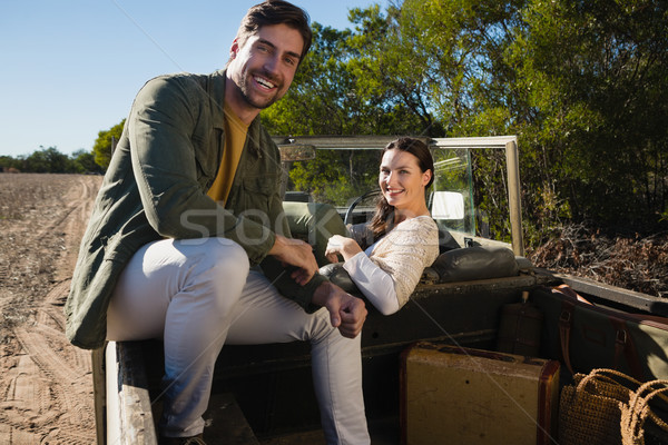 Stock photo: Portrait of smiling couple sitting in off road vehicle
