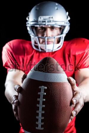 Confident American football player playing Stock photo © wavebreak_media