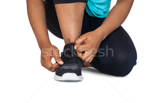 Woman tying her shoelace Stock photo © wavebreak_media