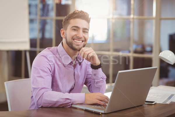 Portrait of businessman working on laptop Stock photo © wavebreak_media