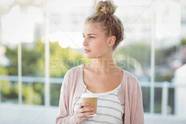 Woman holding coffee cup  Stock photo © wavebreak_media