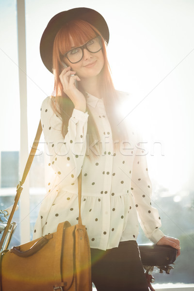 Stock photo: Smiling hipster woman having a phone call