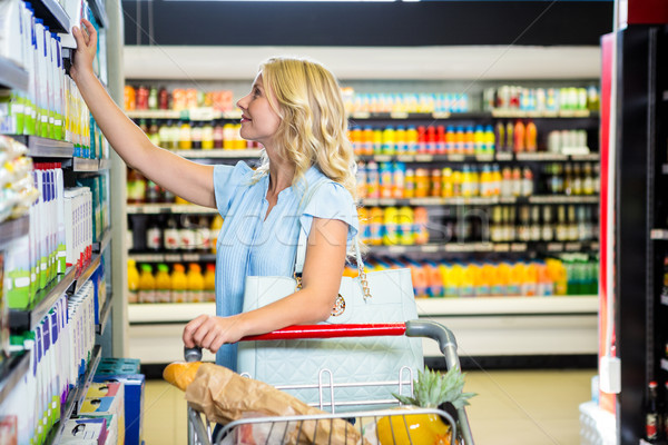 Smiling woman picking dairy products Stock photo © wavebreak_media