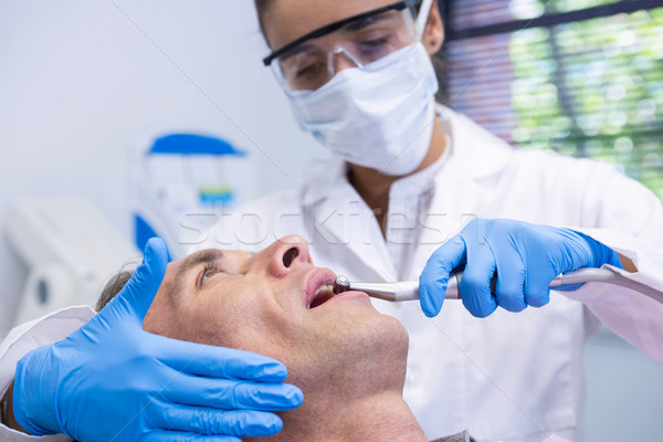 Close up of man receiving dental treatment by dentist Stock photo © wavebreak_media