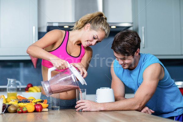 Healthy couple preparing a smoothie Stock photo © wavebreak_media