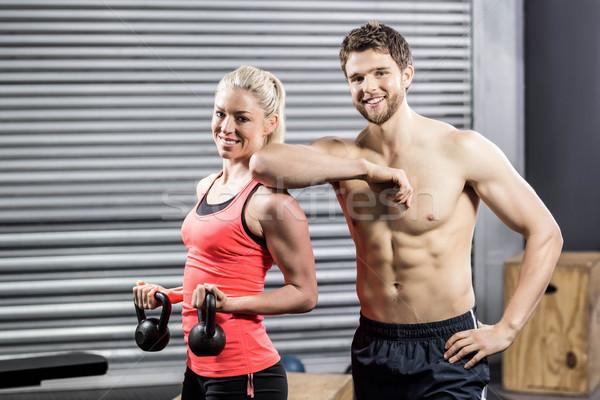 пару позируют гантели crossfit спортзал женщину Сток-фото © wavebreak_media