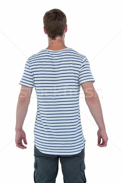 Ver de volta homem branco padrão em pé Foto stock © wavebreak_media