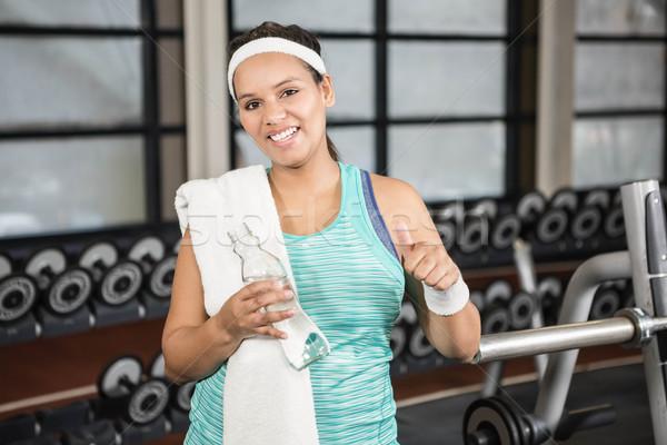 Donna sorridente abbigliamento sportivo palestra mani felice fitness Foto d'archivio © wavebreak_media