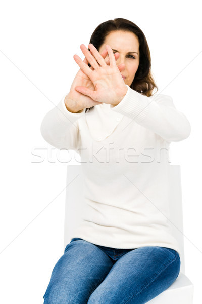 Unhappy woman hiding her face with hands Stock photo © wavebreak_media