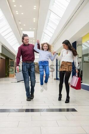 Happy family walking with shopping bags Stock photo © wavebreak_media