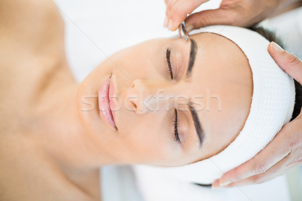 Close-up of pretty woman receiving facial massage  Stock photo © wavebreak_media