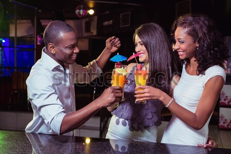 Feliz amigos toma mujer teléfono moda Foto stock © wavebreak_media
