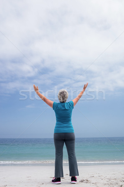 Rear view of senior woman standing on the beach Stock photo © wavebreak_media