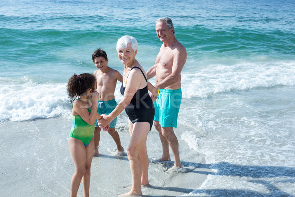 Gelukkig grootouders kinderen permanente strand zee Stockfoto © wavebreak_media