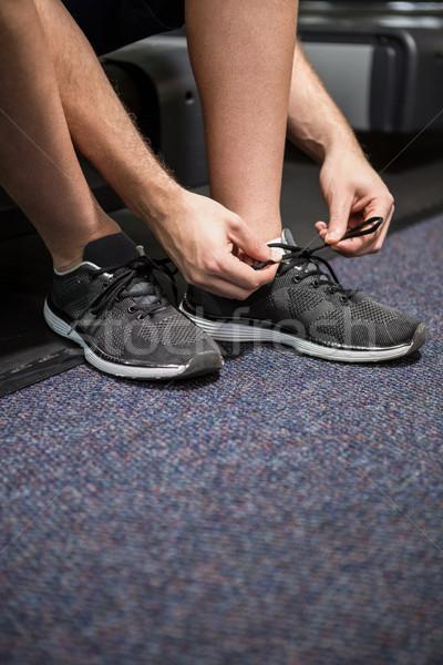 Człowiek w górę buty koronki siłowni zdrowia Zdjęcia stock © wavebreak_media